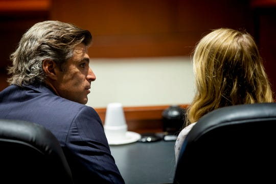 Charles M. Rittgers talks to his client Skylar Richardson during a pretrial hearing Monday, July 1, 2019 at Warren County Common Please Court in Lebanon. Richardson's trial is set for September 3, 2019.