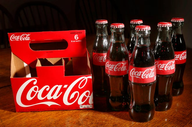 Classic bottles of Coca-Cola are seen Thursday, April 28, 2016, in Concord, N.H.