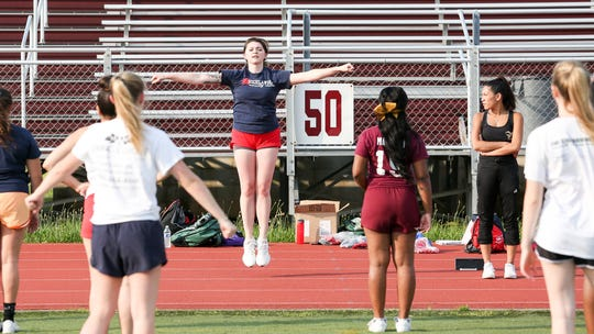 Governor Livingston's cheerleader coach Emily Stecher demonstrates a cheer during the  Union County's Autoland Classic practice at Union High School on July 8, 2019.
