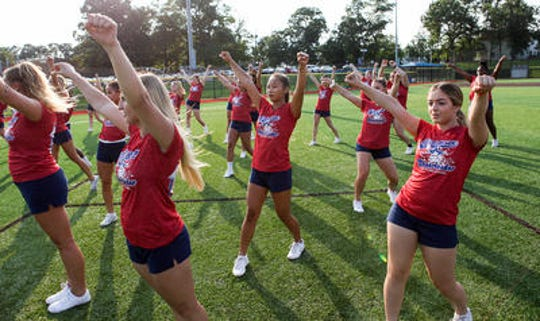 The Middlesex County All-Star cheerleaders practice for the Autoland Classic.