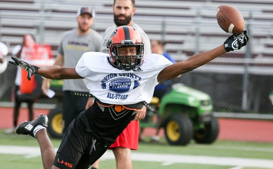 Linden's Schadrac Petit-Homme goes up for a catch during the Union County's Autoland Classic practice at Union High School on July 8, 2019.
