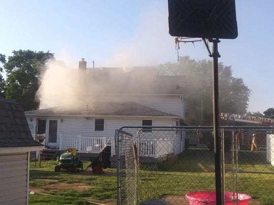 Smoke is scene from a home at 311 W. Main Street in West Lafayette. The blaze occurred about 7:23 p.m. Monday.
