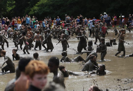 Participants play games in the mud during Mud Day at Edward Hines Park in Westland on Tuesday, July 9, 2019.