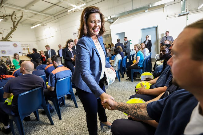 Michigan Gov. Gretchen Whitmer shakes hands with inmates during a press conference announcing DTE Energy's partnership with the Michigan Department of Corrections to create a tree-trimming training program for parolees to fill open, in-demand positions in the industry at the Vocational Village at Parnall Correctional Facility in Jackson, Mich. on Tues., July 9, 2019.