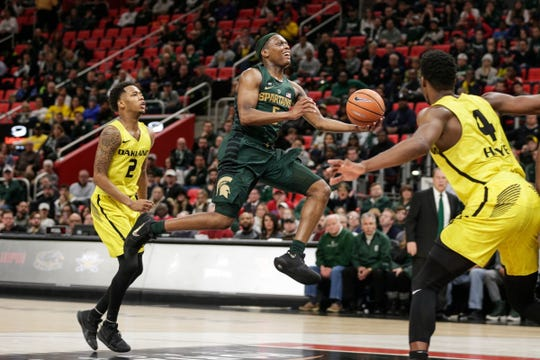 Michigan State's Cassius Winston makes a layup against Oakland in the second half of the Hitachi College Basketball Showcase at Little Caesars Arena in Detroit, Saturday, Dec. 16, 2017.