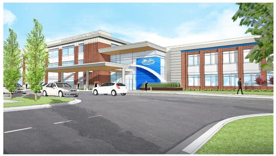 Henry Ford Health System will tear down a vacant Kmart store in Plymouth Township to build a new outpatient center.