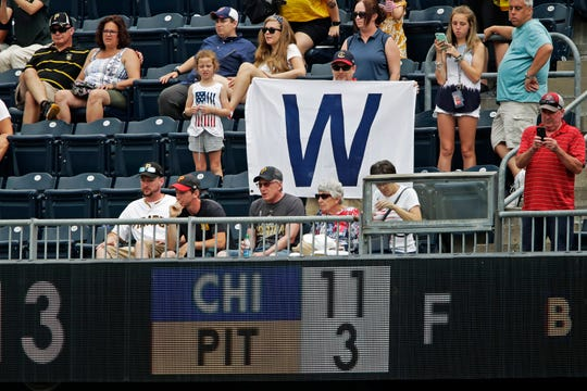 A Chicago Cubs fan holds a sign in the upper deck of PNC Park celebrating an 11-3 Cubs win over the Pittsburgh Pirates in a baseball game in Pittsburgh, Thursday, July 4, 2019.