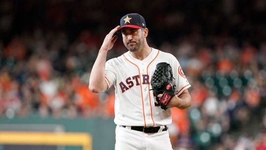 Astros starting pitcher Justin Verlander gestures to the Angels bench before the first inning of their game Friday, a salute following the sudden death of Los Angeles pitcher Tyler Skaggs.