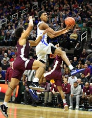 Emoni Bates makes a basket in the state championship game win over U-D Jesuit.