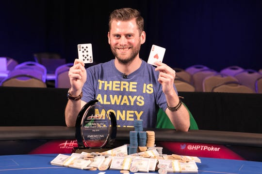 Christopher Moon celebrates his win in the Heartland Poker Tour.