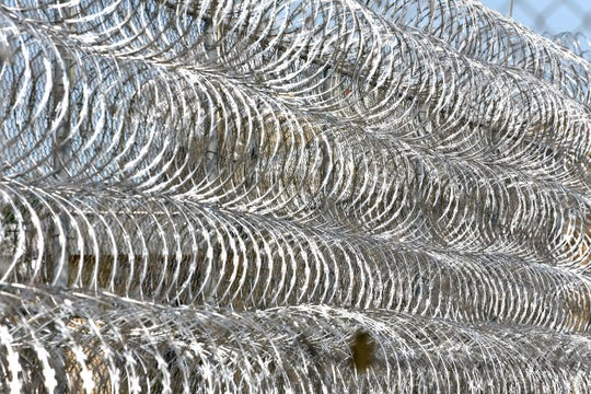 These are rolls of barbed wire near the front entrance of the Parnall Correctional Facility.