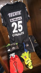 Marco Canales' locker at FC Juarez's Estadio Olímpico Benito Juárez, which includes his Rinat goalkeeper gloves and his No. 25 jersey.