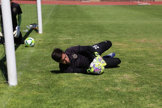 FC Juarez goalkeeper Marco Canales makes a save during training.