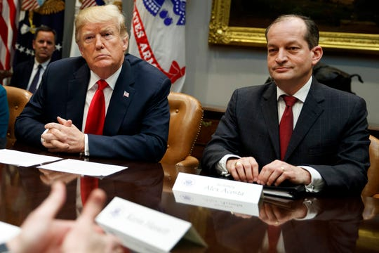 President Donald Trump, left, and Labor Secretary Alexander Acosta at a meeting in September.