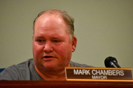 """In this April 2019 photo, Carbon Hill Mayor Mark Chambers speaks at at Carbon Hill, Ala., City Council meeting. Two leaders of the Alabama city have resigned after their Chambers posted a comment on Facebook about """"killing out"""" socialists, """"baby killers"""" and gay and transgender people. Chambers has refused to step down and told residents of Carbon Hill that he plans to run for reelection."""