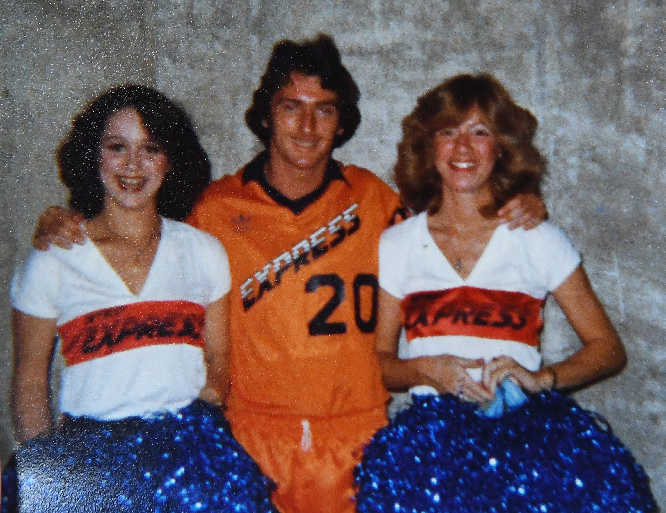 Robin Roberts, left, with Detroit Express soccer player Trevor Francis and Detroit Express Choo Choo Cheerleader Karen Polulak at the Pontiac Silverdome.