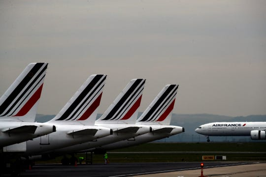 """The French government will implement an """"ecotax"""" on plane tickets for flights departing from France from next year, the government said Tuesday July 9, 2019. The tax is expected to raise over 180 million euros ($200 million) from 2020 to invest in eco-friendly transport infrastructure, including rail."""