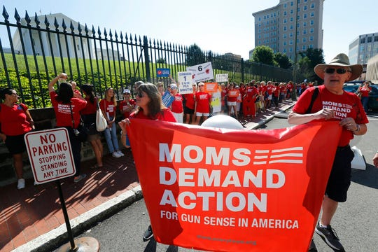 Moms Demanding Action line up during a rally at the State Capitol in Richmond, Va., Tuesday, July 9, 2019.