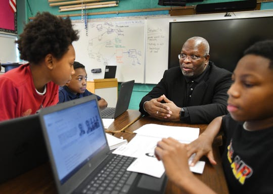 Flint Community Schools Superintendent Derrick Lopez, with Freeman Elementary students El'Geno Garland, Mickial Sadler, and Dejuane Carroll, said the district tried a balanced calendar at the school for three years, with good results.