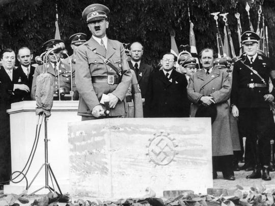 In this May 26, 1938 file photo, German Nazi leader Adolf Hitler speaks lays cornerstone to the Volkswagen car factory in Fallersleben, Lower Saxony, Germany.