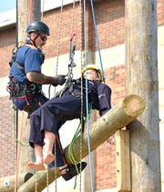 Inmate student Jeffrey Gunnells prepares to rescue this mannequin during a demonstration at the Parnell Vocational Village, Tuesday morning, July 9, 2019.