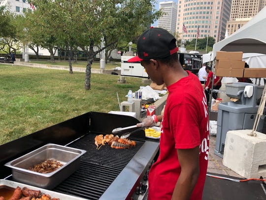Demarco Patrick grills shrimp skewers and lobster tails at the 2018 Great American Lobster Fest at Hart Plaza. It returns for a second year Sept. 13-15.