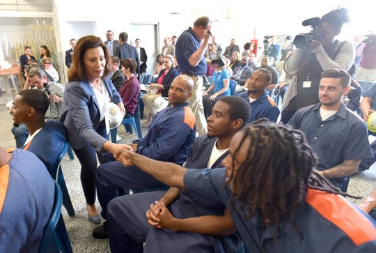 Michigan Governor Gretchen Whitmer shakes hands with inmates in the tree trim training program after speaking at the Parnell Vocational Village in Jackson, Tuesday morning, July 9, 2019.