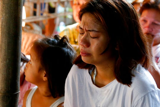 Leejay Acopio, the mother of the slain three-year-old girl Myka Upina, cries during mass at her wake in Rizal province east of Manila Friday, July 5, 2019. The Philippine Commission on Human Rights condemned the killing of the 3-year-old Myka in a police raid in which her father, a drug suspect, was gunned down along with another civilian and a police officer.