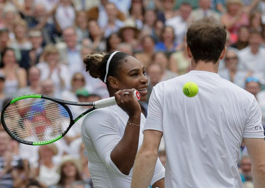 Andy Murray and mixed-doubles partner Serena Williams chat during their match Tuesday.
