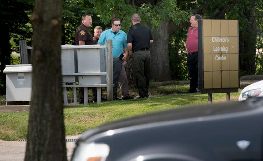 Members of the Vanderburgh County Sheriff Office, at the University of Southern Indiana's Children's Learning Center, investigate the death of a child left in a hot car Tuesday, July 9, 2019.