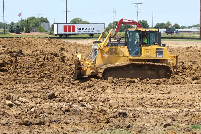 Work continued Tuesday at Fremont Ross High School's new track, as part of Fremont City Schools' plan to build a new high school. Superintendent Jon Detwiler said the existing track will be torn up to make room for the new high school building.