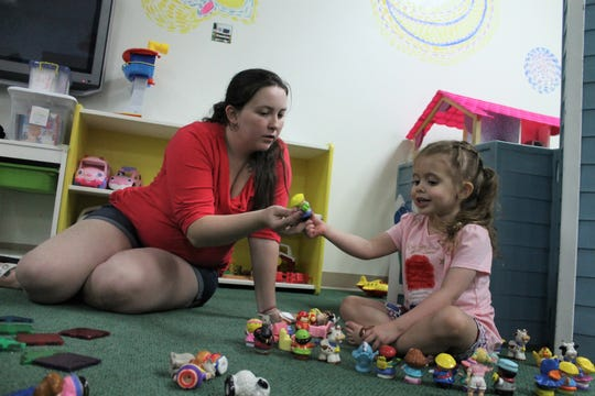 Taia Selburg, left, gives a toy to Piper Sanford at Funshine Early Learning Center and Drop-In Child Care Tuesday, July 9, 2019. Funshine announced it would close Sept. 14.