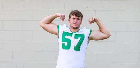 Fort Myers High School three-star offensive lineman Cayden Baker verbally committed to the University of North Carolina.