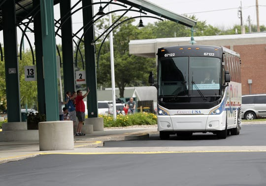 An Amtrak Thruway bus leavesthe Green Bay Metro transit center Monday en route to Milwaukee with stops in Appletopn, Oshkosh and Fond du Lac.
