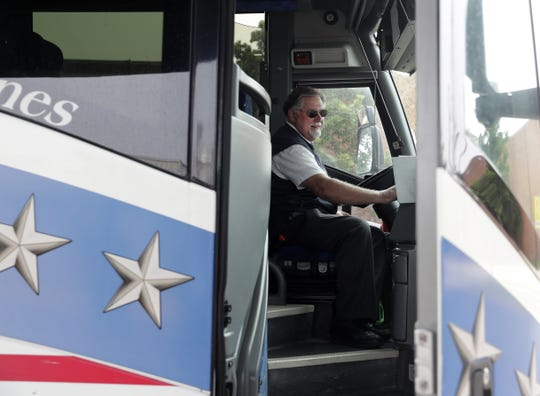 Motorcoach driver Jerry Olson closes the door of an Amtrak Thruway bus before leaving Green Bay Metro transit center en route to Milwaukee.