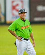 TIm Esmay, manager of the Great Falls Voyagers, coaches third base during Monday evening's game against the Idaho Falls Chukars at Centene Stadium, July 8.