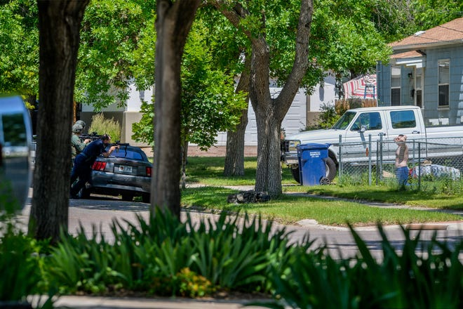 Great Falls Police give intructions to a male in the yard at 1801 Central Avenue on Tuesday afternoon.  He was taken into police custody shortly before 2 p.m.