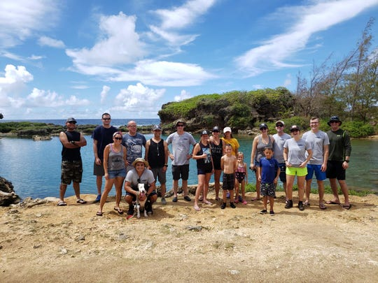 Sailors of USS Asheville, Los Angeles-class fast attack submarine and their families hit the beach in support of the Island Beautification Task Force to clean Inarajan Pools on July 6.