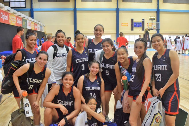 Team Guam is all smiles following a huge 84-48 win over Papua New Guinea at the Pacific Games in Apia, Samoa.