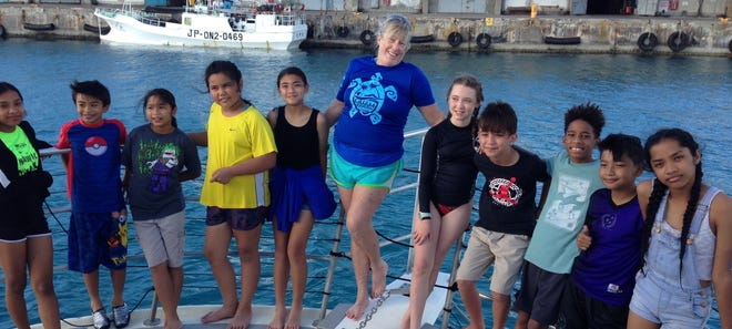 The fifth grade GATE students from Capt. H.B. Price Elementary School participated in their last GATE field trip with a three-hour boat charter on MDA's Sun Chaser from Cabras Marina to Agat Bay on June 5. They observed a juvenile green sea turtle, flying fish, a pod of spinner dolphins, and while snorkeling observed reef fish and coral.  From left: Aumelie Panaguiton, Tag Blas, Felicita Pangelinan, Alexis Gogue, Taelor Mafnas, Vickie Loughran, GATE teacher, Samara Fedenko, Robert O'Brien, Misiah Murphy, Savian Sablan and Everlie Panaguiton.