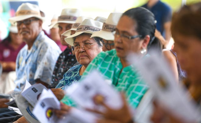 World War II survivors and others gather for the unveiling of the Kålaguak Memorial in Tiyan, Barrigada, in this July 9, 2019, file photo.