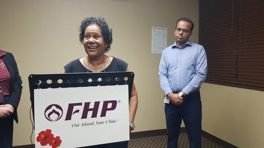 Virginia McMahon, a consultant with the University of Hawaii Cancer Center, speaks during a press conference at FHP in Tamuning on July 9, 2019. Beside her is Dr. Samir Ambrale.