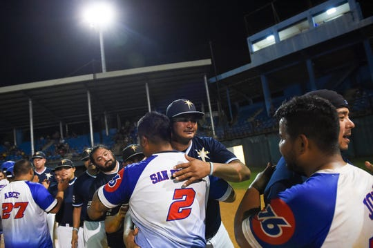 IT&E Rays and 76 Expos players shake hands following Game 4 of their 2019 Guam Major League Championship Series game at Paseo Stadium in Hagåtña, July 9, 2019. The Rays defeated the Expos 8-5, to become the 2019 GML champions.