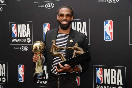 June 24, 2019; Los Angeles, CA, USA; Memphis Grizzlies guard Mike Conley poses with his teammate of the year awards at the 2019 NBA Awards show at Barker Hanger.