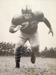 He was known as Richard Afflis in an Indiana high school, but became famous as Dick the Bruiser. He's shown as a Green Bay Packer.
