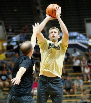 Robbie Hummel, seen shooting during the 2018 Purdue Alumni basketball game,  is a candidate to be one of four players on the Tokyo team.