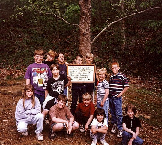 Students in Joan Goble's third grade class pose with a sign they made for the Moon tree in Cannelton, Indiana. Emails from Goble sparked a worldwide search for other trees.