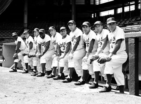 Carl Erskine, at right, as the starting pitcher for Brooklyn Dodgers in 1954. Other famous faces, from left, are:  Junior Gilliam, Peewee Reese, Duke Snider, Jackie Robinson, manager Walter Alston, Roy Campanella, Gil Hodgers, Carl Furillo, Billy Cox.Photo/Jacob Harris)