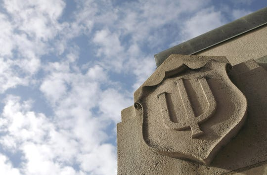 IU logo in limestone on building on Indiana University-Bloomington campus.