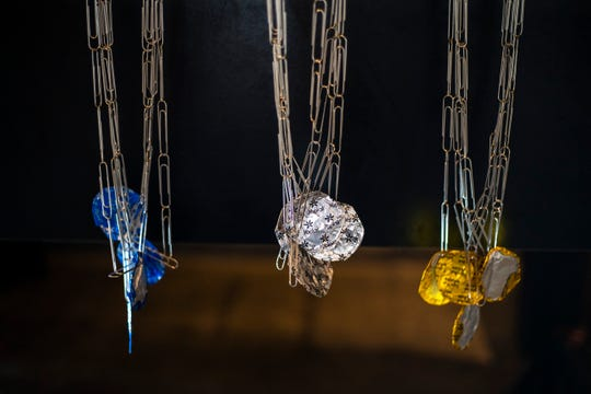 "Blue, silver and gold colored Yoplait yogurt lids dangle from paper clip chains during an ""Office Olympics"" fundraiser hosted by Riverside Theatre, Monday, July 8, 2019, at Big Grove Brewery and Taproom in Iowa City, Iowa."